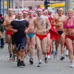 Half naked santa runners don't feel cold
