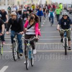 Photo-cyclechic: girl with a camera on a bike at Critical Mass