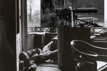 US soldier killed by a German sniper on the balcony of a house in Leipzig on April 18, 1945. - Photo by Robert Capa